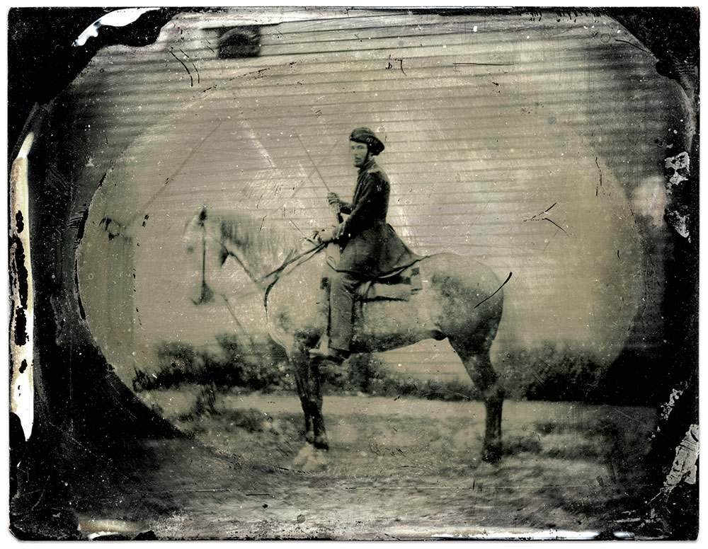 Pvt. James Lawrence Secrest, Jeff Davis Legion of Cavalry, pictured with Sela. Quarter-plate ruby ambrotype by an unidentified photographer. Rick Brown Collection of American Photography.
