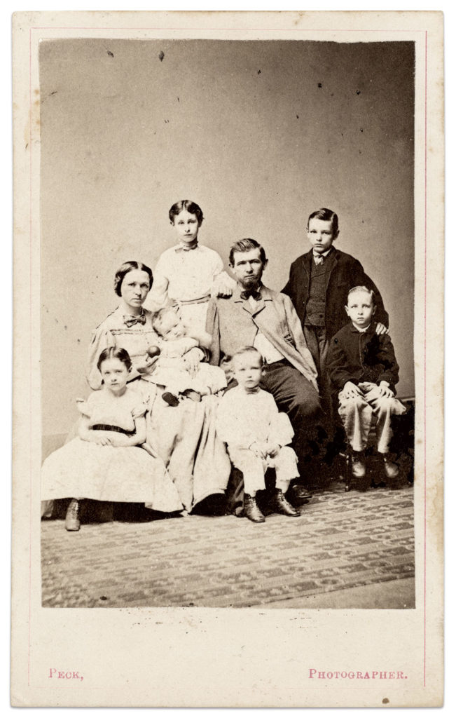 Warner and his family. Carte de visite by Henry S. Peck of New Haven, Conn. Author's collection.