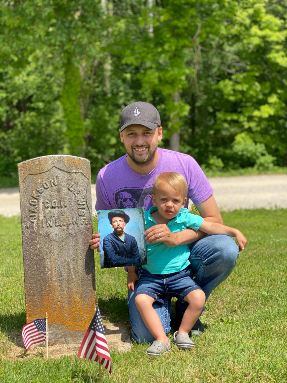 Jed Brian, with his son in tow, visits the grave of Andrew Jackson Lewis (1836-1884) in Little Zion Cemetery in Pike County, Ind. Lewis, who served in the ranks of Company I, 17th Indiana Infantry, is Jed's great-grandfather. Jed holds a colorized restoration of an original tintype.