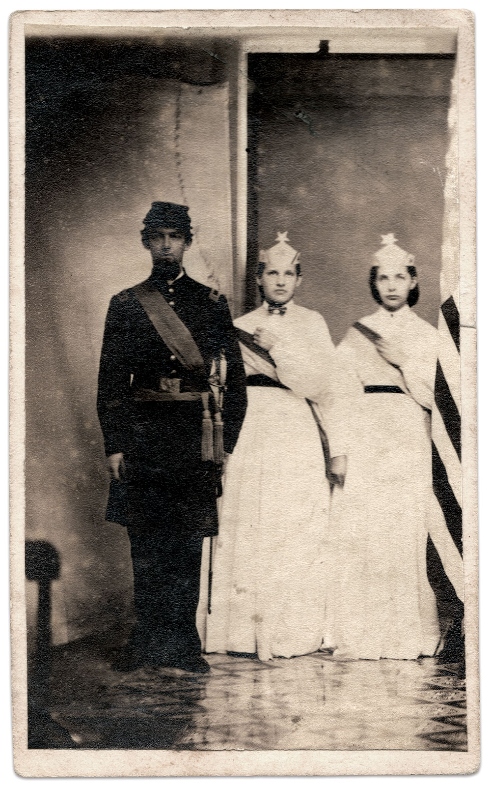 SPECIAL  OCCASION: This officer stands with two ladies dressed in Goddess of Liberty costumes for Gettysburg  photographer Levi H. Mumper,  Author's Collection.