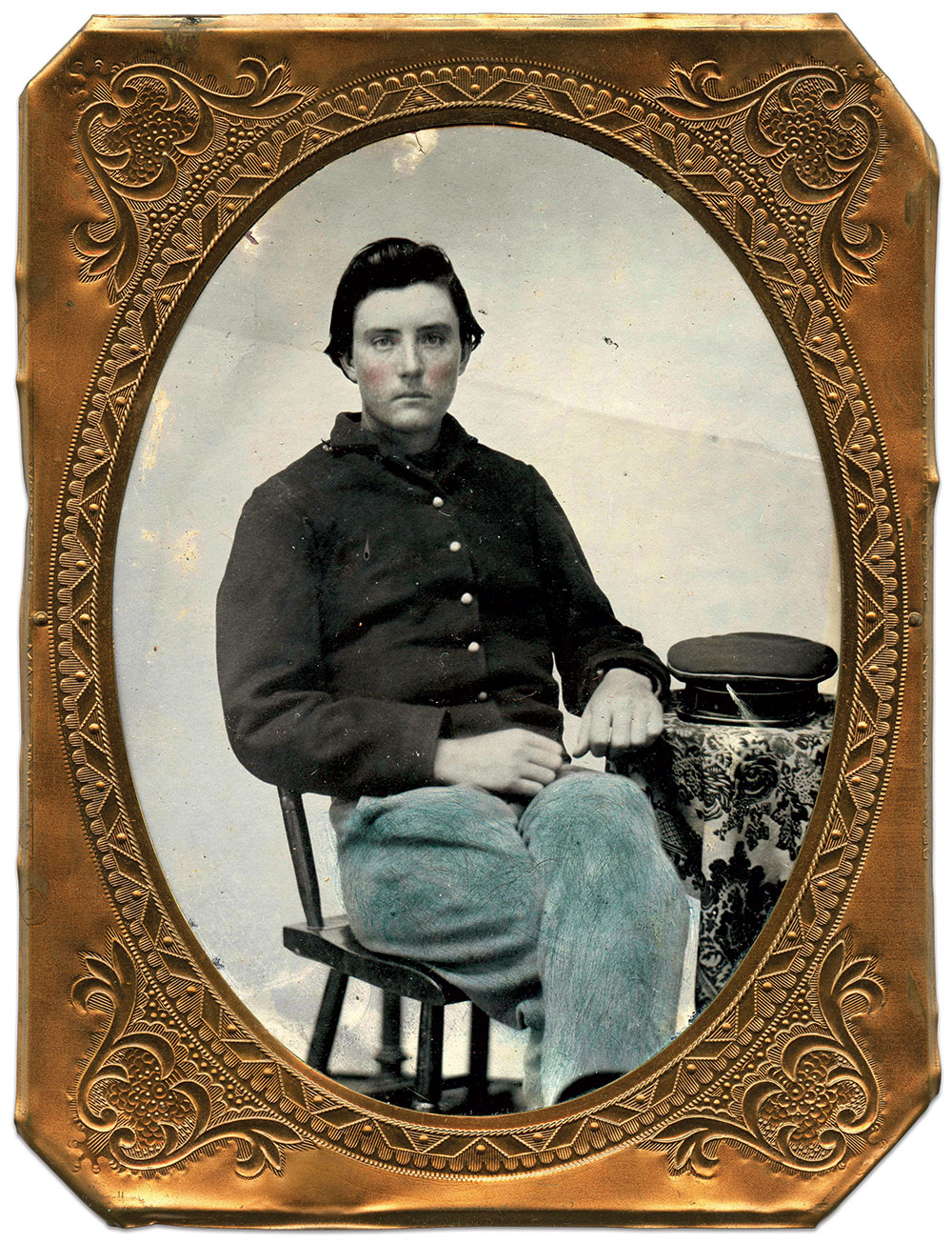 THE MMB CAP: Pvt. William R. Houts is pictured about 1863 with the Marine Brigade's distinctive Germanic wheel-hat with leather visor trimmed with a green band and white facing. Quarter-plate tintype by an unidentified photographer. Author's Collection.