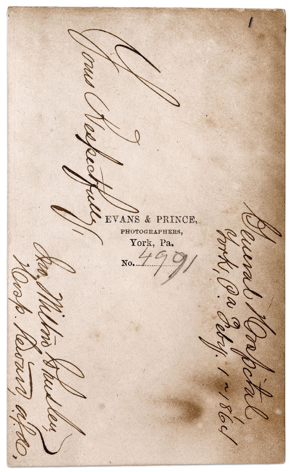 IDENTIFYING MARKS: The back of the mount of the carte de visite of Hospital Steward John M. Johnston is inscribed in ink with his name, rank, location and date. A small pencil number 1 in the top right corner is consistent with the position inside the frame, and the order of his signature on The Compact. In the center are the photographer's imprint and the negative number.